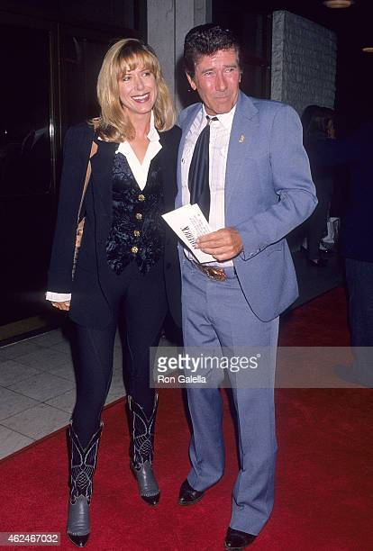 Actress Jennifer Savidge and actor Robert Fuller attend the Maverick Westwood Premiere on May 12 1994 at the Mann National Theatre in Westwood...