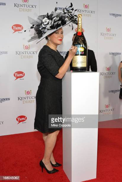Actress Jennifer Tilley signs the Moet Chandon 6L for the Churchill Downs Foundation during the 139th Kentucky Derby at Churchill Downs on May 4 2013...