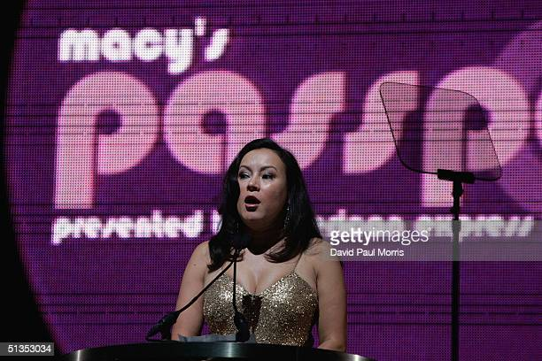 Actress Jennifer Tilly reads a letter from Elizabeth Taylor at the beginning of the 22nd annual Macy's Passport 04 evolution/revolution presented by...
