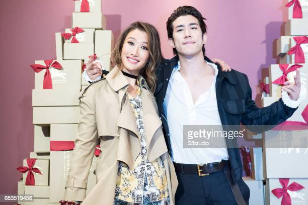 Actress Jennifer Tse and Actor Aarif Lee pose for a photograph on the red carpet at the Burberry Pacific Place event on 03 November 2016 in Hong...
