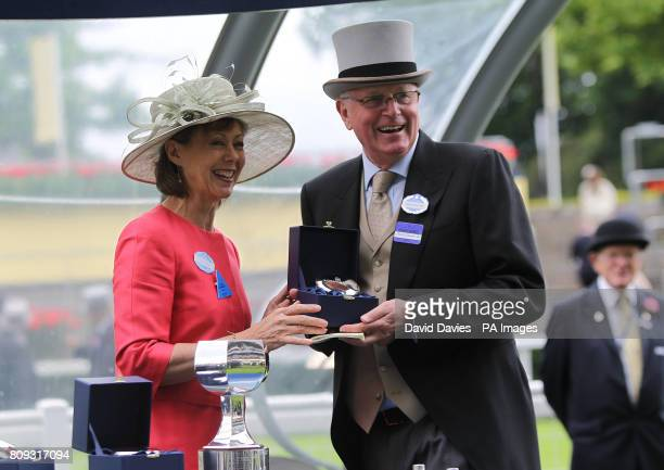 Actress Jenny Agutter presents trainer Mick Channon with his medal after winning the Albany Stakes with Samitar on day four of the Royal Ascot...