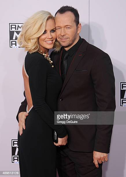 Actress Jenny McCarthy and actor/singer Donnie Wahlberg arrive at the 2014 American Music Awards at Nokia Theatre LA Live on November 23 2014 in Los...