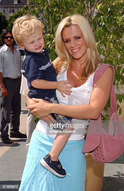 Actress Jenny McCarthy and her son Evan Asher arrive at the opening of Nana's Garden on June 26 2004 at Nana's Garden in Los Angeles California...