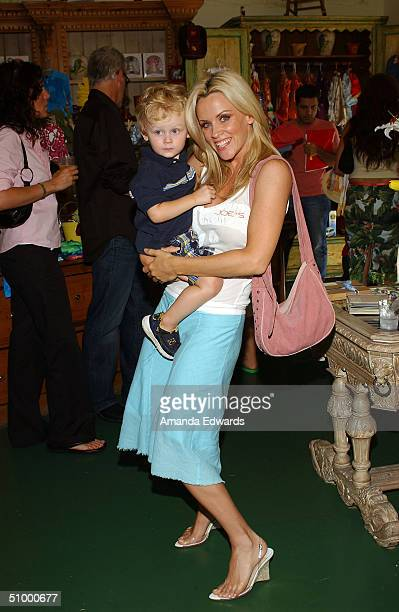 Actress Jenny McCarthy and her son Evan Asher poses at the opening of Nana's Garden on June 26 2004 at Nana's Garden in Los Angeles California Nana's...