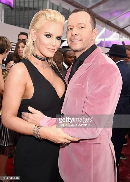 Actress Jenny McCarthy and singer Donnie Wahlberg attend the 2016 American Music Awards at Microsoft Theater on November 20 2016 in Los Angeles...