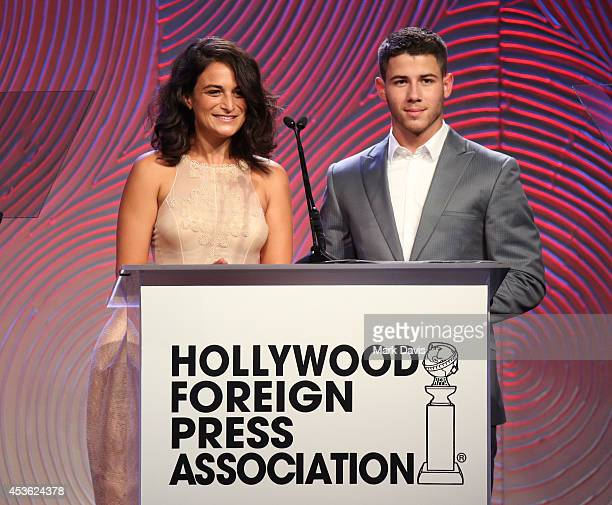 Actress Jenny Slate and musician Nick Jonas speak onstage at the Hollywood Foreign Press Association's Grants Banquet at The Beverly Hilton Hotel on...