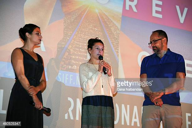 Actress Jenny Slate Director Gillian Robespierre and SIFF Director Carl Spence talking on stage at the Egptian Theater screening of Obvious Child on...