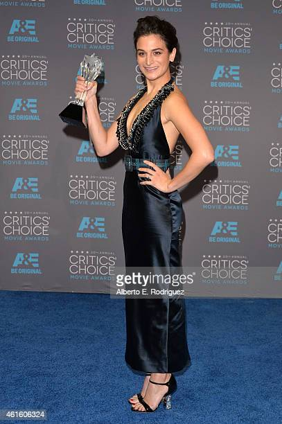 Actress Jenny Slate winner of Best Actress in a Comedy for 'Obvious Child' poses in the press room during the 20th annual Critics' Choice Movie...