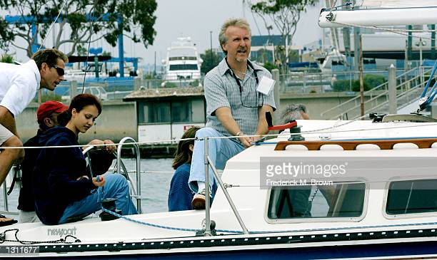 Actress Jessica Aba center and producer James Cameron right sit aboard a yacht during a race at the Santa Monica Windjammers Yacht Club for the...