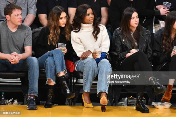 Actress Jessica Alba and Gabrielle Union attend a basketball game between the Los Angeles Lakers and the Miami Heat at Staples Center on December 10...