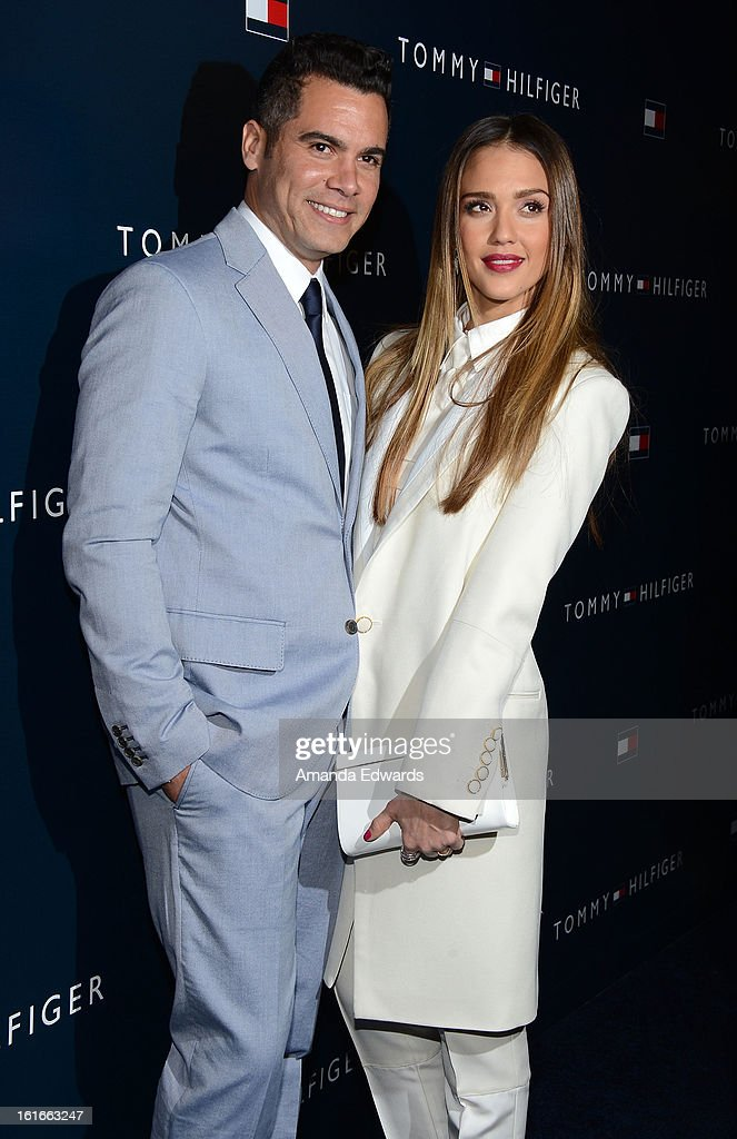 Actress Jessica Alba (R) and her husband Cash Warren arrive at the Tommy Hilfiger West Coast Flagship Grand Opening Event at Tommy Hilfiger West Hollywood on February 13, 2013 in West Hollywood, California.
