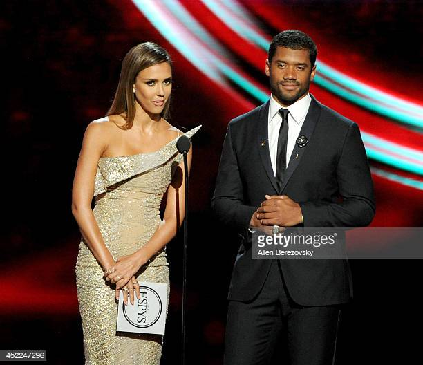 Actress Jessica Alba and NFL player Russell Wilson speak onstage at the 2014 ESPY Awards at Nokia Theatre LA Live on July 16 2014 in Los Angeles...
