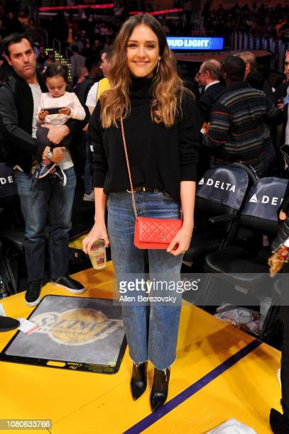 Actress Jessica Alba attends a basketball game between the Los Angeles Lakers and the Miami Heat at Staples Center on December 10 2018 in Los Angeles...