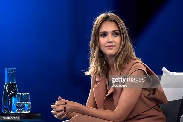 Actress Jessica Alba cofounder of The Honest Co listens to a presentation during the DreamForce Conference in San Francisco California US on Thursday...