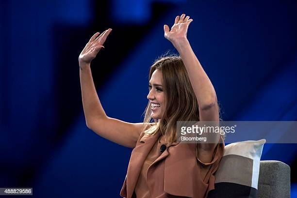 Actress Jessica Alba cofounder of The Honest Co raises her hands during the DreamForce Conference in San Francisco California US on Thursday Sept 17...