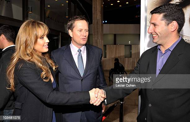 Actress Jessica Alba Michael Burns and Nick Meyer attend the premiere of The Eye at the Pacific Cinerama Dome on January 31 2008 in Los Angeles...