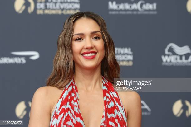 US actress Jessica Alba poses for a photocall as she arrives for the opening ceremony of the 59th MonteCarlo Television Festival in Monaco on June 14...