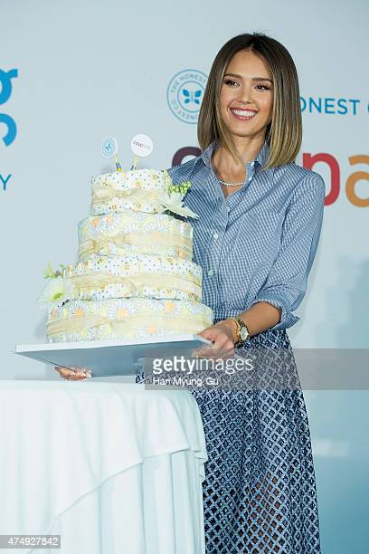 Actress Jessica Alba poses for media as she holds diaper the press conference for Ecommerce company COUPANG at the Grand Intercontinental Hotel on...