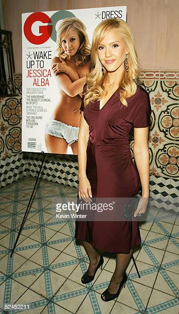 Actress Jessica Alba poses next to her cover at a party to celebrate GQ Magazine's April Issue at The Spider Club on March 18 2005 in Los Angeles...