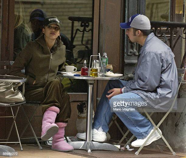Actress Jessica Alba sits at a restaurant with an unidentified man October 21 2005 in New York City