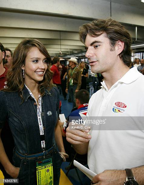 Actress Jessica Alba speaks with Jeff Gordon driver of the DuPont/Department of Defense Chevrolet at the drivers meeting prior to the NASCAR Nextel...