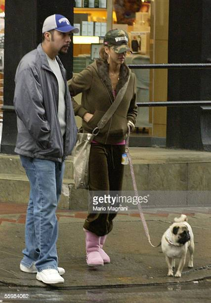 Actress Jessica Alba stands on the street with an unidentified man October 21 2005 in New York City