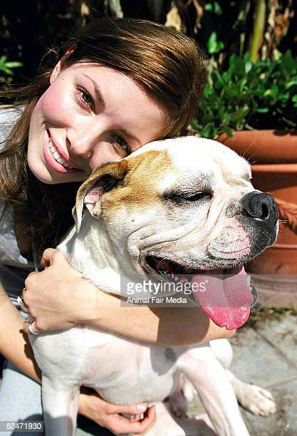 Actress Jessica Biel poses for a portrait with her Bulldog East at the Santa Monica Pier June 2003 in Santa Monica California