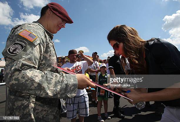 Actress Jessica Biel signs memorabilia in the garage area prior to the NASCAR Sprint Cup Series CocaCola 600 at Charlotte Motor Speedway on May 30...