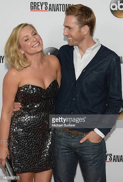 Actress Jessica Capshaw and Christopher Gavigan arrives at the 'Grey's Anatomy' 200th Episode Celebration at The Colony on September 28 2013 in Los...