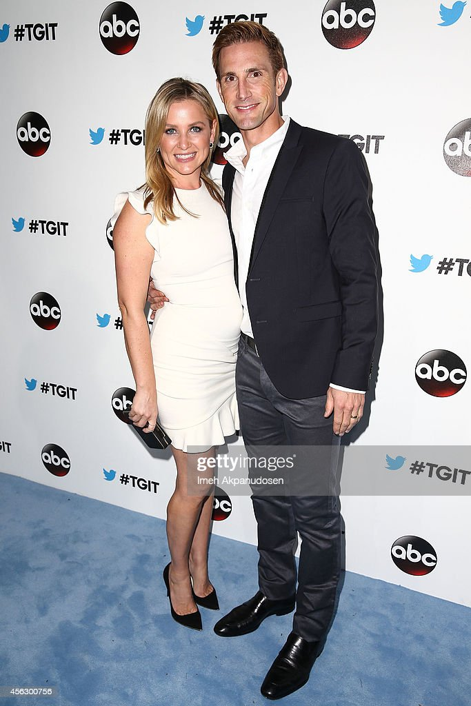 Actress Jessica Capshaw (L) and husband Christopher Gavigan, attend the TGIT Premiere event at Palihouse on September 20, 2014 in West Hollywood, California.