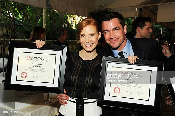 Actress Jessica Chastain and Director Tate Taylor pose with the Year of Excellence Awards for The Help and Tree of Life during the 12th Annual AFI...