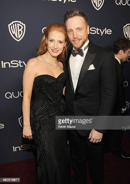 Actress Jessica Chastain and Editor of InStyle Ariel Foxman attend the 2014 InStyle And Warner Bros. 71st Annual Golden Globe Awards Post-Party at...