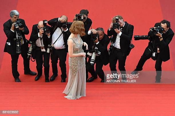 TOPSHOT US actress Jessica Chastain poses on May 12 2016 as she arrives for the screening of the film 'Money Monster' at the 69th Cannes Film...