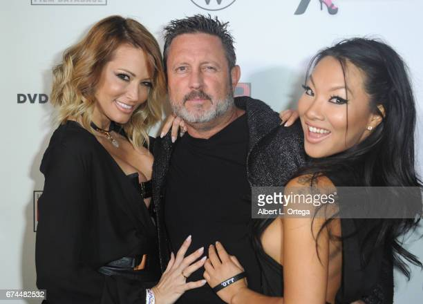 Actress Jessica Drake, director/husband Brad Armstrong and actress Asa Akira arrive for the 33rd Annual XRCO Awards Show held at OHM Nightclub on...