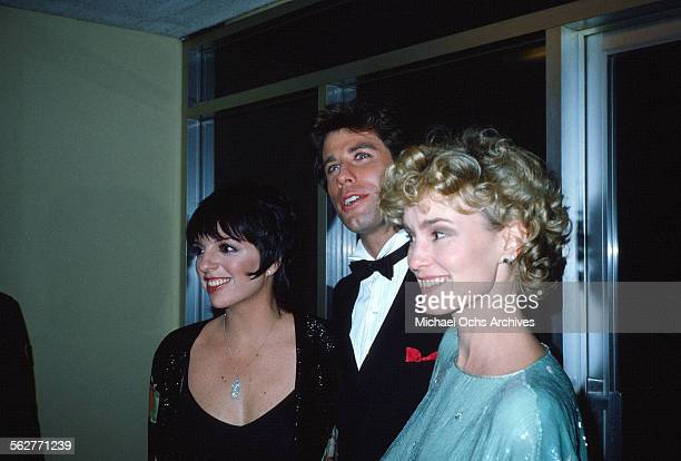 Actress Jessica Lange arrives with John Travolta and Liza Minnelli to the 55th Academy Awards at Dorothy Chandler Pavilion in Los AngelesCalifornia