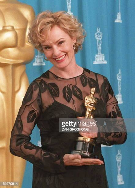 US actress Jessica Lange holds the Oscar she won for her role as Carly Marshall in the film Blue Sky 27 March at the Academy Awards in Los Angeles...