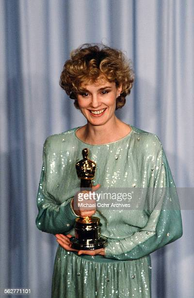 Actress Jessica Lange poses backstage after winning Best Supporting Actress at the 55th Academy Awards at Dorothy Chandler Pavilion in Los...