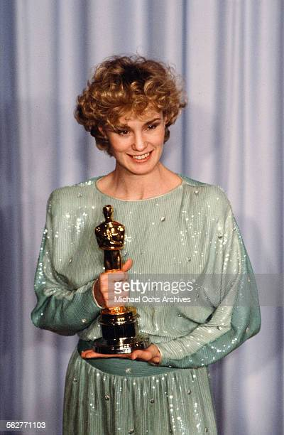 Actress Jessica Lange poses backstage after winning 'Best Supporting Actress ' at the 55th Academy Awards at Dorothy Chandler Pavilion in Los...