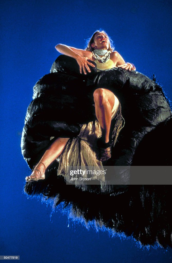 Actress Jessica Lange screaming as she is lifted by giant ape hand in scene fr. motion picture King Kong.