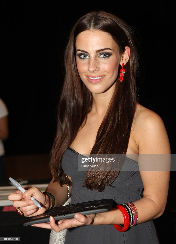 Actress Jessica Lowndes poses with Motorola Xoom at the Maxim Party Powered by Motorola Xoom at Centennial Hall at Fair Park on February 5, 2011 in Dallas, Texas.
