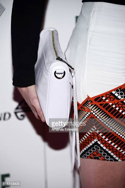 Actress Jessica Morris clutch detail arrives at the premiere of Broad Green Pictures' The Dark Horse at The Theatre at Ace Hotel on March 30 2016 in...