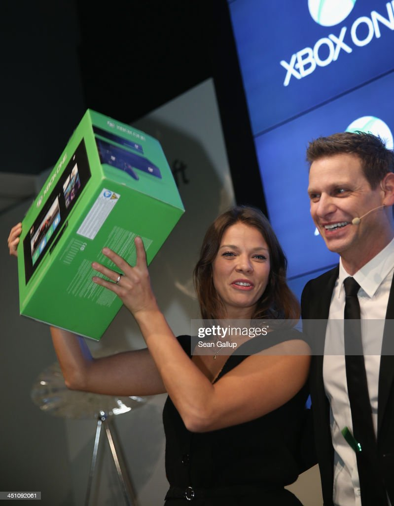 Actress Jessica Schwarz (L) and Microsoft Germany Consumer Channel Group General Manager Oliver Kaltner attend the launch party of the Microsoft Xbox One at the Microsoft Center on November 21, 2013 in Berlin, Germany. Microsoft is launching the new console to compete against the new Sony Playstation 4 ahead of Christmas.