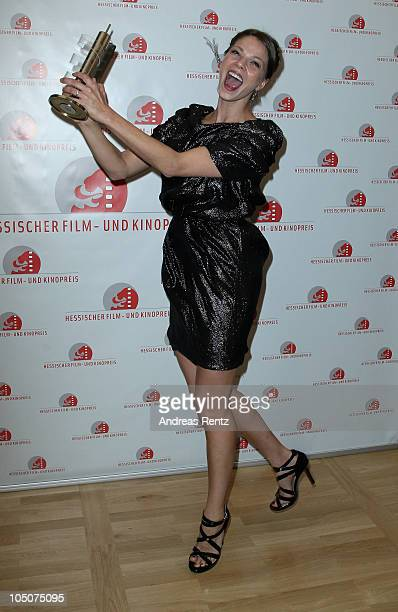 Actress Jessica Schwarz poses with the award during the 'Hesse Movie Award 2010' at the Alte Oper on October 8 2010 in Frankfurt am Main Germany...