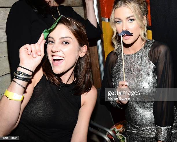 Actress Jessica Stroup and actress Carmen Electra attend the 90210 100th Episode Celebration at Pink Taco Sunset Strip on September 29 2012 in Los...