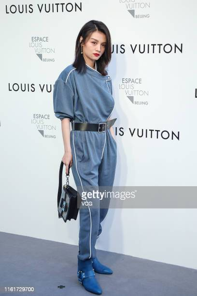 Actress Jessie Li attends Louis Vuitton Coming of Age exhibition on July 12 2019 in Beijing China