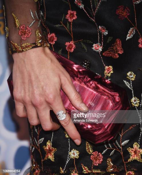 Actress Jessy Schram clutch detail arrives at the Hallmark Channel 'Once Upon A Christmas Miracle' screening and holiday party at 189 by Dominique...