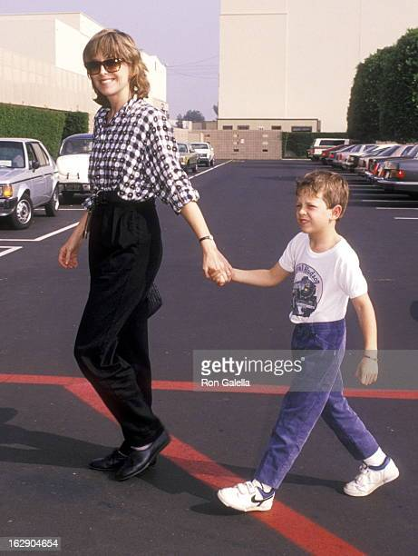 """Actress Jill Eikenberry and son Max Tucker attend the """"Oliver & Company"""" Burbank Premiere on November 6, 1988 at Walt Disney Studios in Burbank,..."""