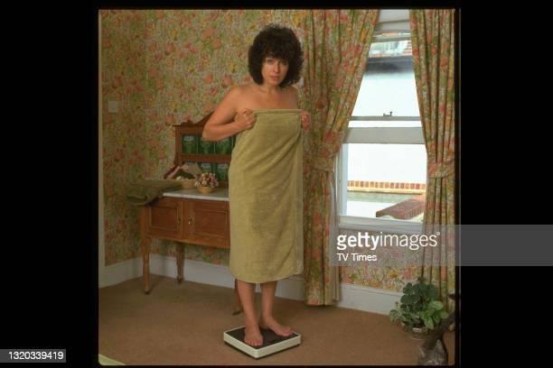 Actress Jill Gascoine weighing herself at home, circa 1984.