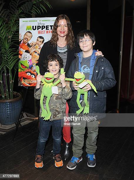 Actress Jill Hennessy Marco Mastropietro and Gianni Mastropietro attends the Disney The Cinema Society screening of Muppets Most Wanted at Tribeca...