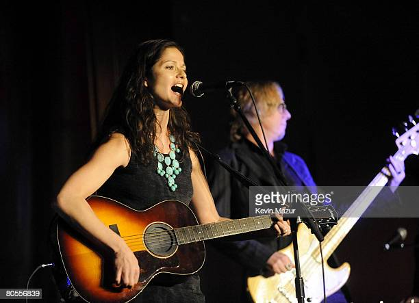 Actress Jill Hennessy performs on stage with musician Mike Mills of REM during the Food Bank For New York City's 5th Annual CanDo Awards Dinner at...